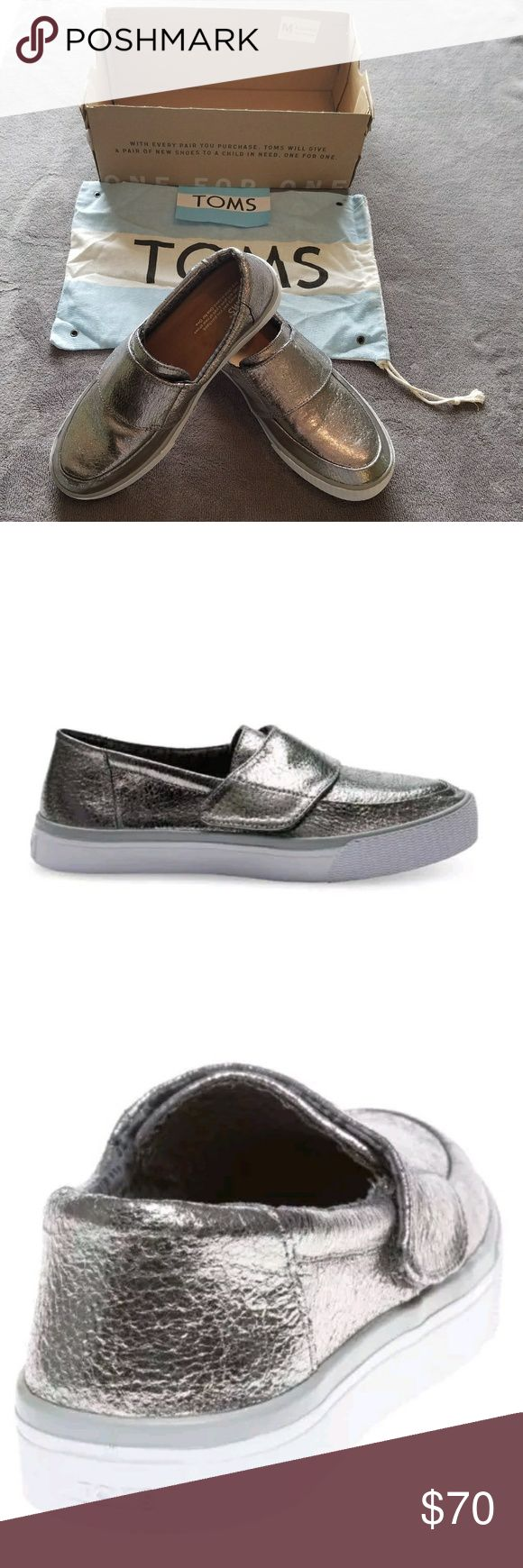 TOMS Altair Gunmetal Leather Slip On Shoes Sz 8 NEW Women's Toms Metallic Grey Altair Slip On Leather Shoes Flats Sz 8  Comes with sticker, Dust Bag and Bottom part of the shoe box.  The TOMS Altair plimsolls are the perfect slip on shoe, appearing in cracked metallic uppers and featuring a velcro top strap, the aztec lining and thick white rubber outsole completes this design.  Color - Gunmetal Leather Main Upper Material - Leather Slip On, Hook and Loop Fastener  Comfort Insole TOMS tonal…