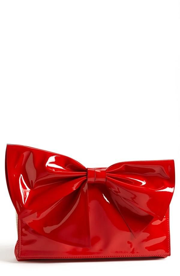 Wow! Red shiny bow clutch by Valentino.