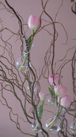 interesting:  wire on to branches in a vase little glass vials or vases for fresh flowers