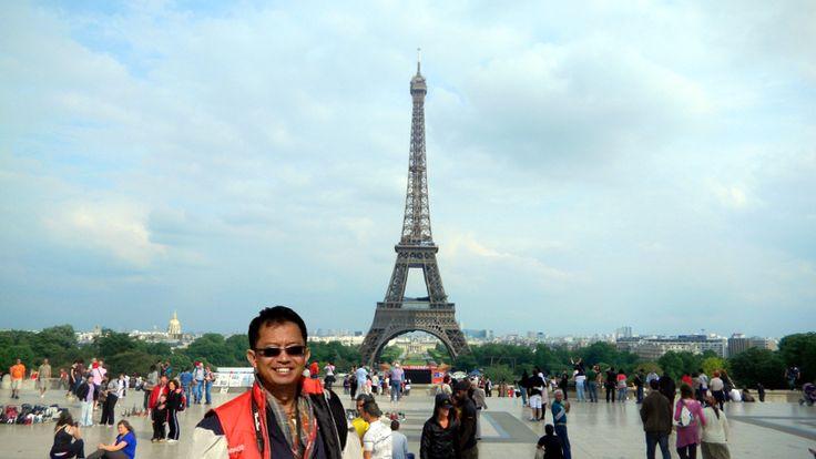 liburan hebat Paris hasil dari aplikasi atm ponsel