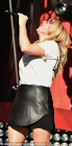 Giving it her all: Ellie added statement shades as she belted out her hits in the sunshine