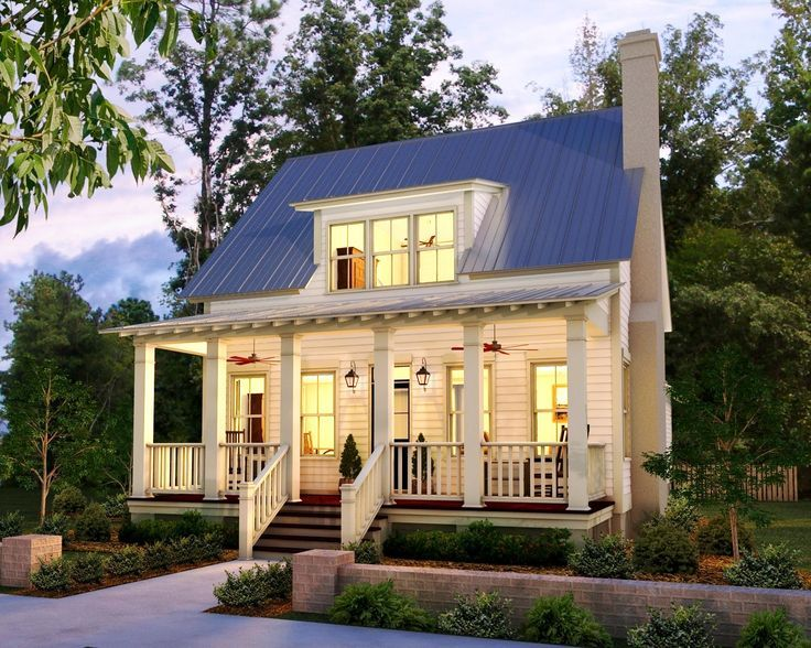 this petite farmhouse has a welcoming porch that seems to say come sit for - Small Home