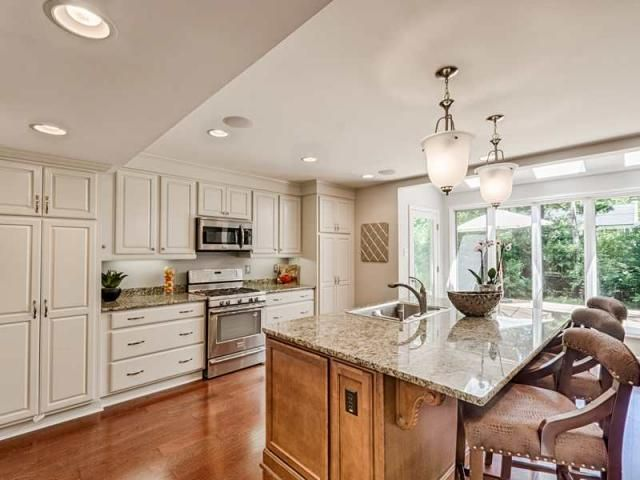 White cabinets for the perimeter warm for Pearl white kitchen cabinets