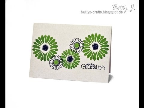 cardmaking video ... watch a clean and simple card being made in under two minutes ... clean and simple card with a band of green and black daisies ....