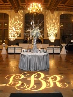 Projection of bride and groom monogram