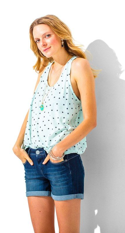 Sleeveless racerback tank with all over navy dot print on mint.