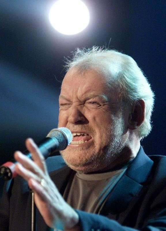 """In this March 23, 2002 file photo, British singer Joe Cocker performs during the television game show """"Bet It...?!"""" ('Wetten Dass...?!') in Munich, southern Germany.  Cocker, best known for the songs, """"You Are So Beautiful,"""" and the 1980s duet """"Up Where We Belong,"""" with Jennifer Warnes, died Monday, Dec. 22, 2014 of lung cancer in Colorado. He was 70."""