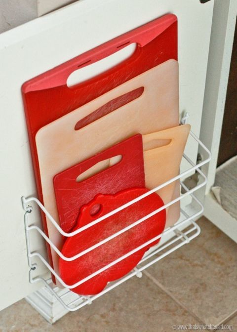 When you run out of storage space in your kitchen (trust us, it will happen eventually), make more with the help of a wire holder on the side of a cabinet door. Cutting boards are thin so you can fit several in at once. See more at That's What Che Said »