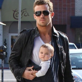 Stylish dad with baby sling.uh don't you mean hot dad with baby sling?