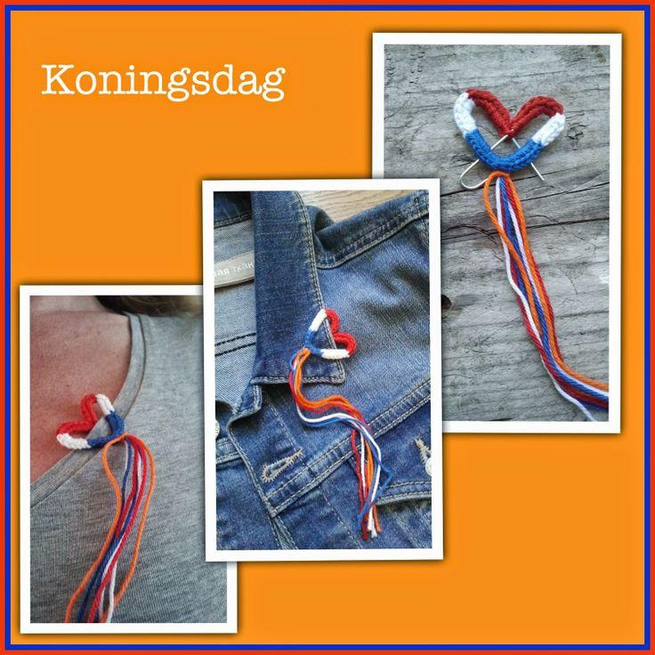 Voor Koningsdag een  paperclip gebogen in en hart vorm en om gehaakt met rood wit en blauw