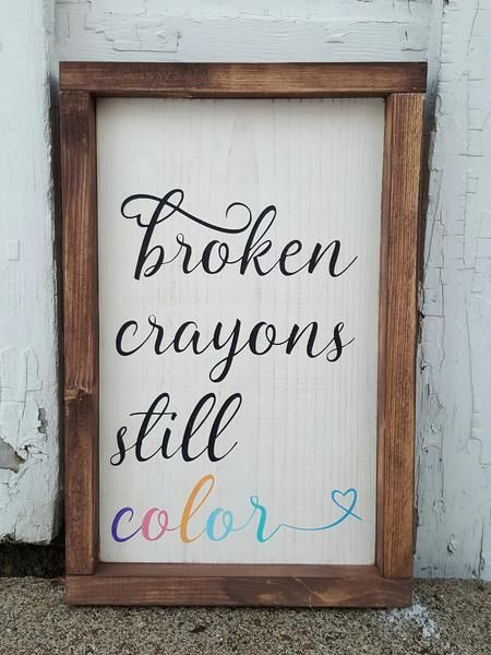 """This framed wood sign is an absolute favorite of mine and a much needed reminder for so many of us. Broken crayons still color Approximately 9"""" x 13"""" Off-white"""