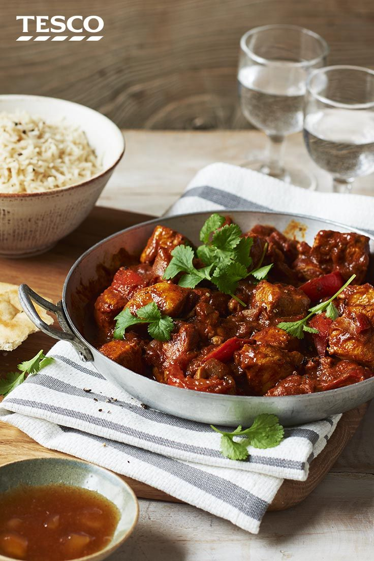 Cook up a tasty curry in a hurry with this easy chicken curry recipe. With a hearty tomato sauce and spicy hit of Madras curry paste, this is the perfect recipe for a Friday night in, or speedy weeknight meal. | Tesco