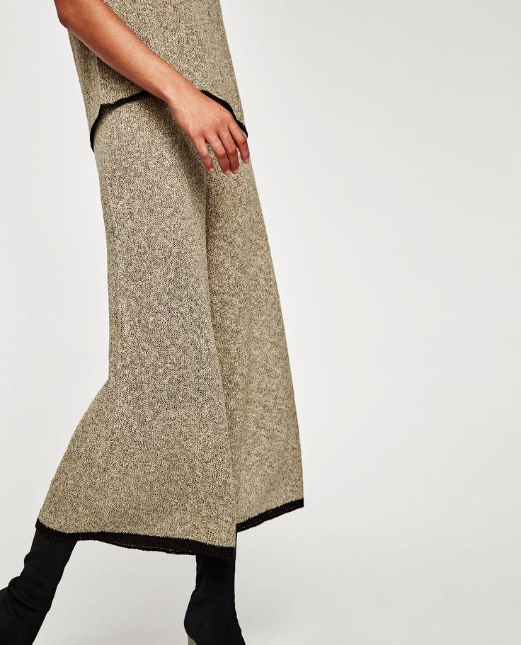ZARA PANTALÓN PUNTO    Pantalón de punto con cintura elástica y bajo con vivo a contraste.
