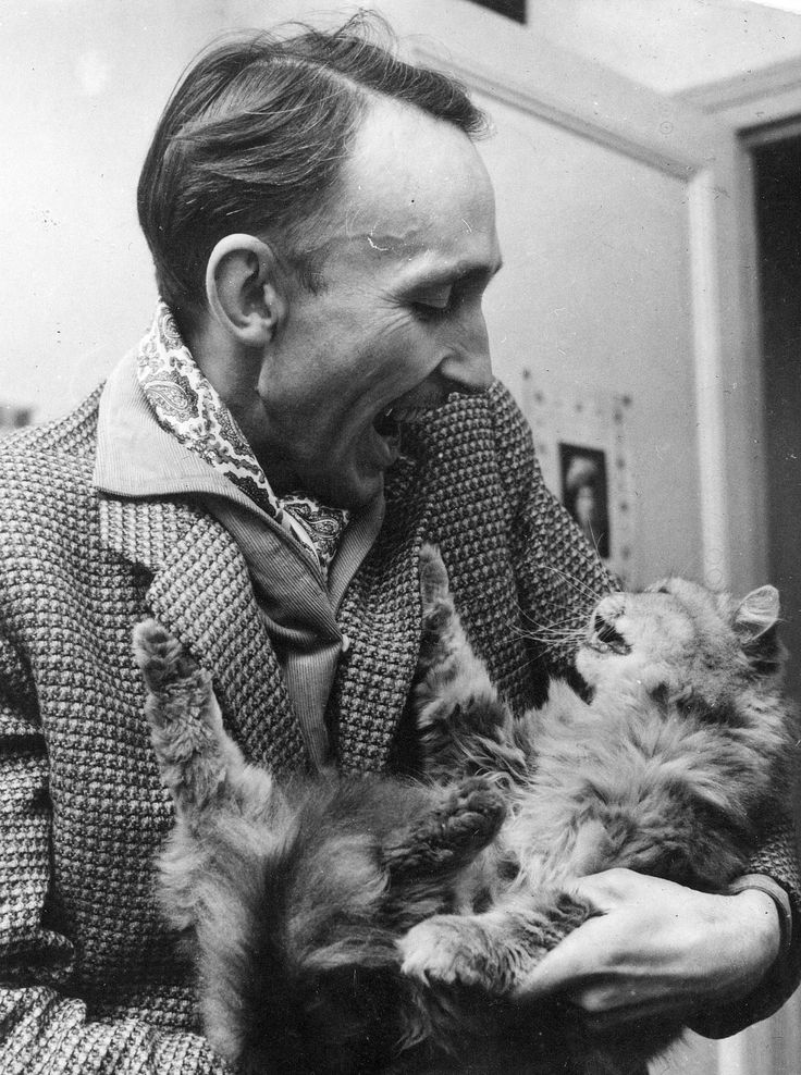 Andre Bazin with cat.