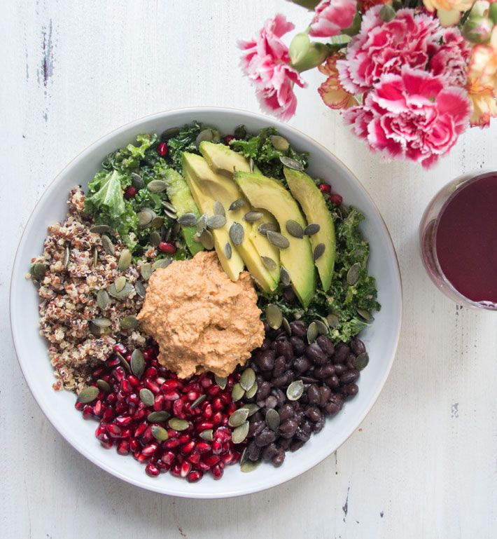 - four big handfuls of kale  - 1/3 of a cup of pomegranates  - 1 ripe avocado  - a handful of pumpkin seeds  For the dressing  - 1 tablespoon of olive oil  - 1 teaspoon of teaspoon of tahini  - 1 teaspoon of apple cider vinegar or 1 lime  - 1 teaspoon of tamari  - 1 lime