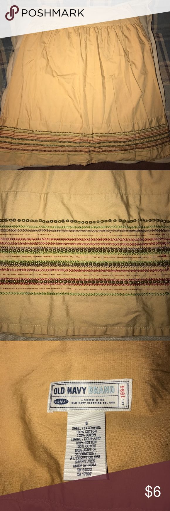 OLD NAVY Cotton Studded Hem Skirt Pre-owned OLD NAVY tan cotton skirt with green and red threaded design hem and gold studs. Size 6. In excellent condition. Old Navy Skirts A-Line or Full