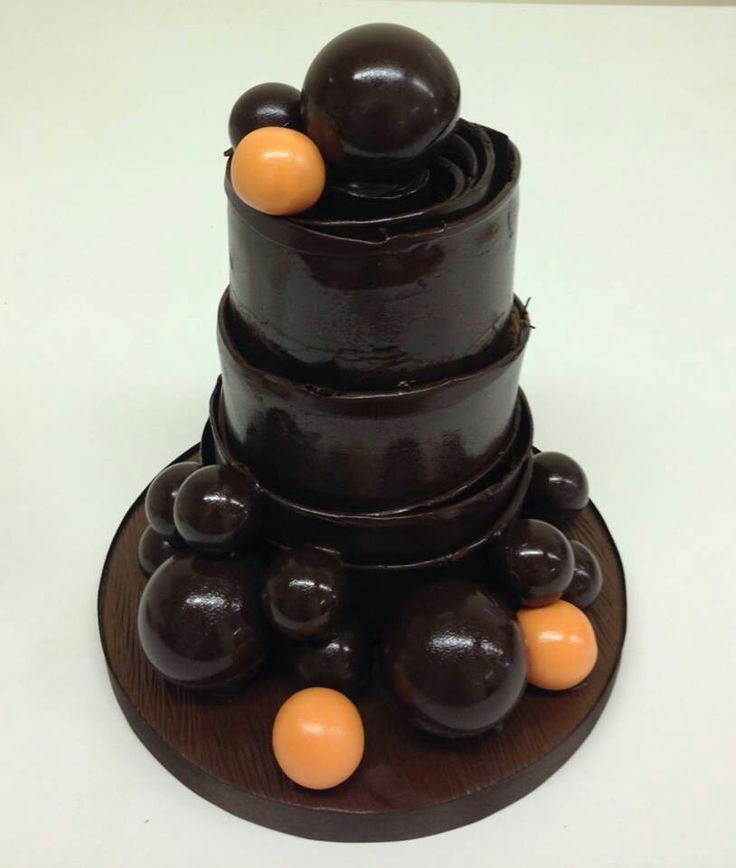 A little mini chocolate cake for an Anniversary. Their wedding cake was 5 tiers of this style