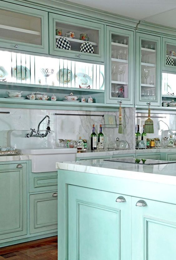 Turquoise kitchen! Love the shell pulls, and the... - Magical Home Inspirations