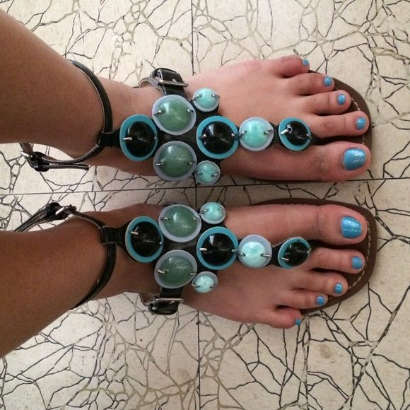 Sandals (Turquoise/Jade Green/Black Accents)  Brand: Rampage. These sandals are so unique and one of a kind, I've never seen anyone else with these sandals  absolutely stunning and gorgeous! Well-loved as shown in the third picture, but can absolutely spice up any wardrobe and make you stand out  will post additional pics of wear in a separate listing.  NO TRADES, NO HOLDS, NO PAYPAL, NO MERCARI  smoke free, pet free home  let me know if you have any other questions  Rampage Shoes Sandals