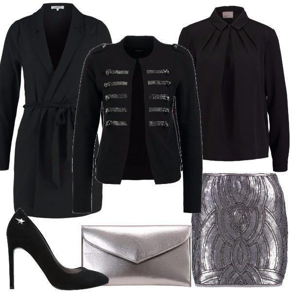 Ecco un outfit adatto per i festeggiamenti di capodanno: minigonna argentata con dettagli neri, camicia nera con pieghe sul décolleté, blazer nero con dettagli in paillettes argentate, cappottino classico nero, décolleté nero con stellina argentata e pochette argento.