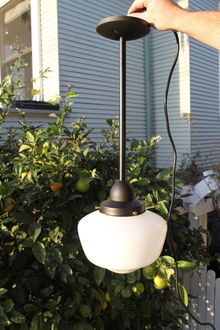 DIY Schoolhouse pendant light project... would be awesome in brass with a large milk glass globe