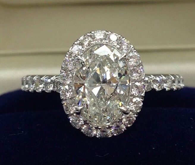 Oval diamond engagement ring with diamond halo and diamond shank
