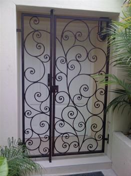 Cute security door . . . or something like it would be cool (i love wrought iron!)