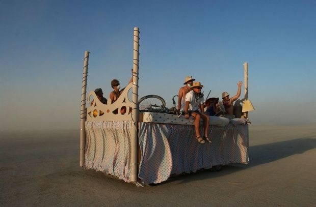 People ride around on an art car at the Burning Man Festival.
