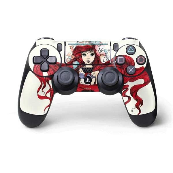"""Let Ariel be front and center on your PS4 Pro/Slim Controller with Disney's The Little Mermaid """"Ariel Illustration"""" PS4 Pro/Slim Controller Skin. This Little Mermaid PS4 Pro/Slim Controller Skin features an original Disney art drawing of Ariel with sea flowers in her hair. The """"Ariel Illustration"""" PS4 Pro/Slim Controller Skin is the perfect Disney accessory to show off your love for The Little Mermaid. Whether you have the new slim PS4 Slim or PS4 P..."""