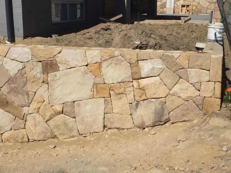 Stone retaining wall.  #stonewall