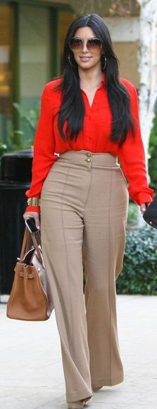 Who made Kim Kardashian's nude high waisted pants, platform pumps, handbag, and red button down top that she wore in Los Angeles on January 12, 2012?