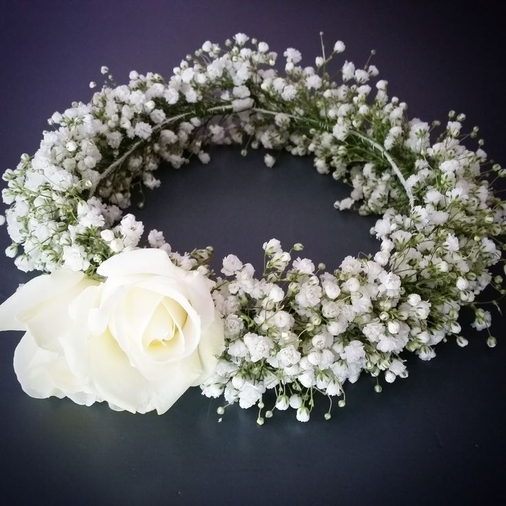 Babybreath with a couple of roses in a sweet wreath for a flower girl.