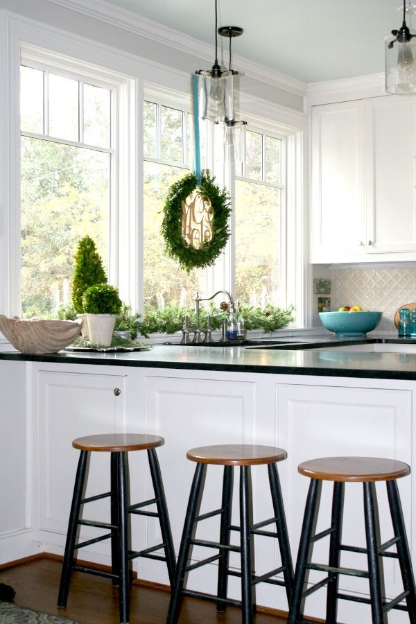 Black and White Kitchen with Festive Greenery