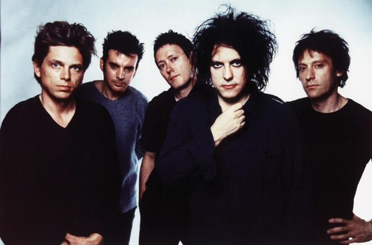 The Cure, circa 1991. It's never cool to like the band whose frontman is iconic for his pale complexion, wild hair and smudged lipstick (a sad clown if there ever was one). Interestingly though, Smith, known for his frequently gloomy and introspective lyrics, has been the only constant member of the band as if his loneliness pervades all aspects of his life and music. Always wondered this--the Cure for what? Happiness? Sadness? Could be both.