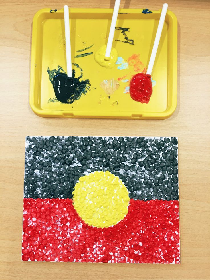 We made our own canvas Aboriginal flags in honour of National Sorry Day using cotton filters to create the small dots!