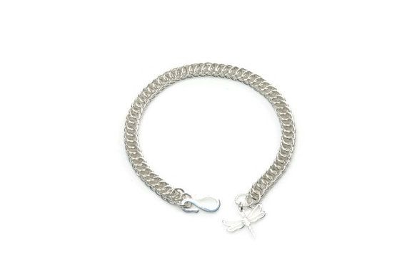 Handmade following the Half Persian pattern, from over 100 individually linked rings. This bracelet is 925 Sterling Silver, and has been