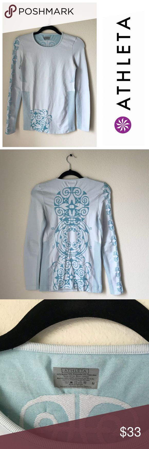 Athleta Long Sleeve Aqua Fitted Gym Top Sporty Athleta Long Sleeve Aqua Fitted Gym Top!  🏃🏽‍♀️ Size M 🏃🏽‍♀️ light pastel blue & teal coloring 🏃🏽‍♀️ thick & stretchy material  🏃🏽‍♀️ cool tribal/floral design down back & sleeve 🏃🏽‍♀️ fitted cut 🏃🏽‍♀️ crew neck  Materials  82% Nylon  12% Polyester  6% Spandex Athleta Tops