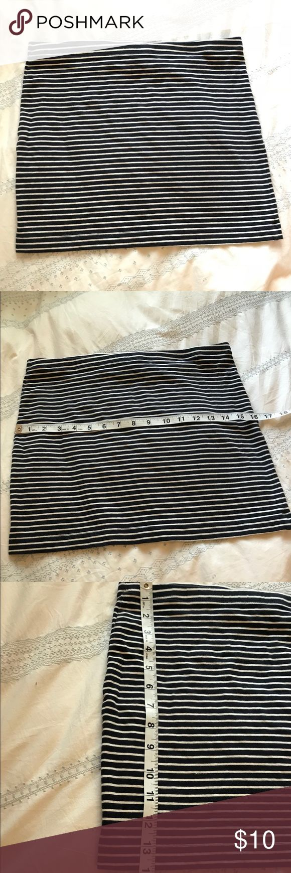 H&M Basic Striped Body-con Skirt Super soft and comfortable navy and white stripe body-con skirt by H&M. There is a small mark from lipstick because my roommate thought this item was a tube top before deciding to not wear it. This item has a lot of life left, and I hope someone out there needs a flattering skirt! H&M Skirts Mini