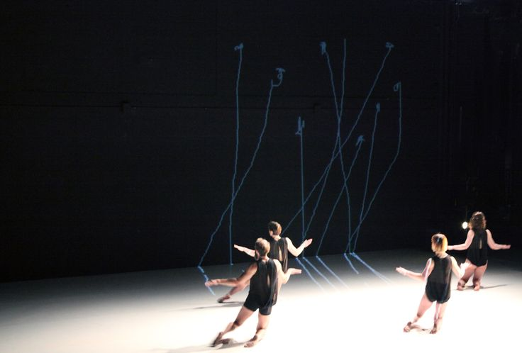 Set-design for dance at New York Live Arts, by Anna Schuleit Haber, using light in real time to create a live drawing all across the stage