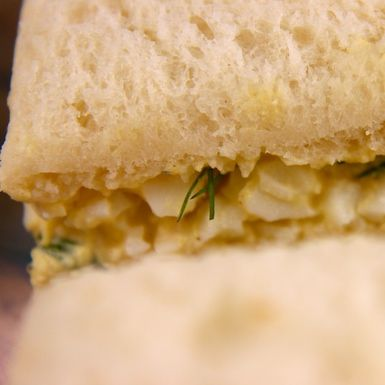 Simple Egg Salad Tea Sandwiches Recipe: A bit of mustard, dill and parsley give these egg salad finger sandwiches a mild flavor.