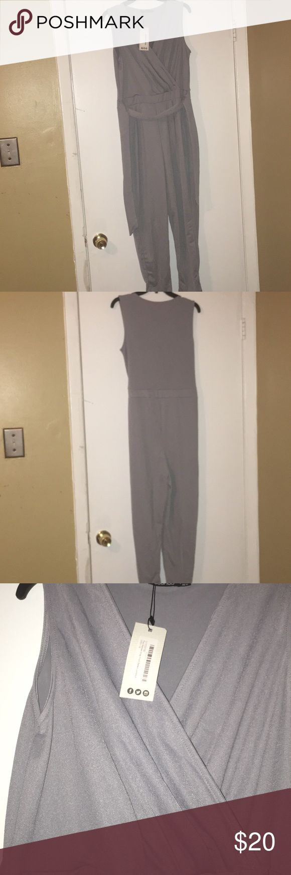 Women's plus size Boohoo jumpsuit size 14 Women's plus size Boohoo jumpsuit size 14 brand new with tags, jumpsuit is free from any stains, rips, tears or holes all clothing comes from pet free and smoke free home all prices are negotiable and reasonable offers will be seriously considered, cleaning out my closets so make me an offer, prices are heavily discounted and ready to move Boohoo Plus Pants Jumpsuits & Rompers