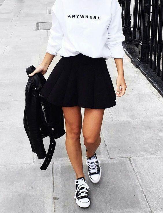 "white ""anywhere"" sweatshirt + black motorcycle jacket + black neoprene skater skirt + black lowtop Converse"