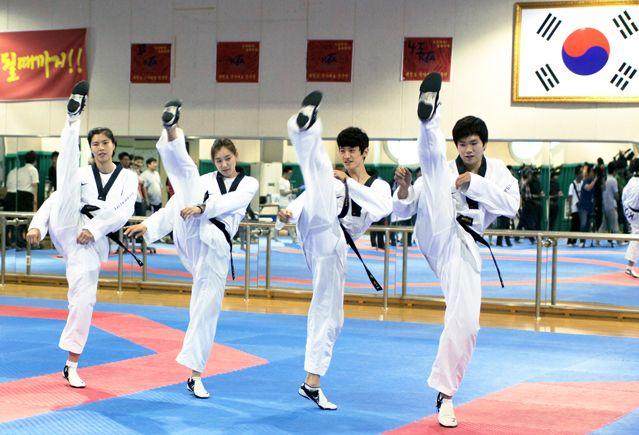 The 2012 London Olympic Taekwondo team, with (from left) Lee In-jong, Whang Kyung-seon, Lee Dae-hoon, and Cha Dong-min, demonstrates high kicks during the Media Day event on July 10 (photo courtesy of Korea Taekwondo Association).