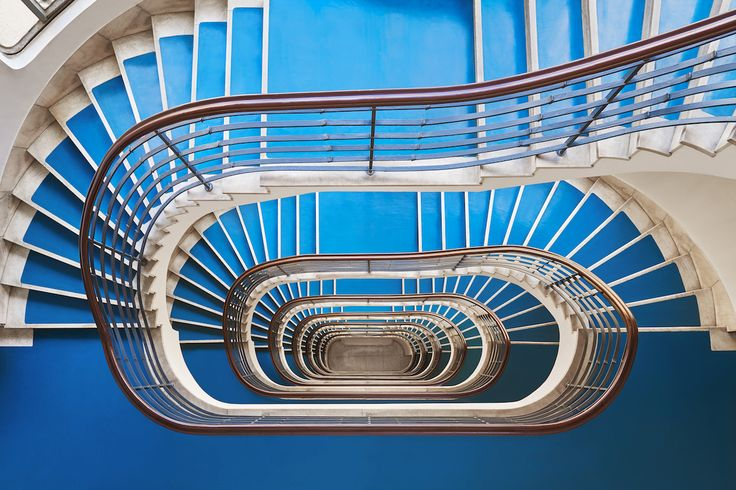Time Machine series is a deliberate study of Bauhaus caracoles in Budapest, Hungary. Along with a strict concept, the unified photographs show spiral staircases from the same central perspective. Due to the pulling energy of spiral forms, the works of Tim…
