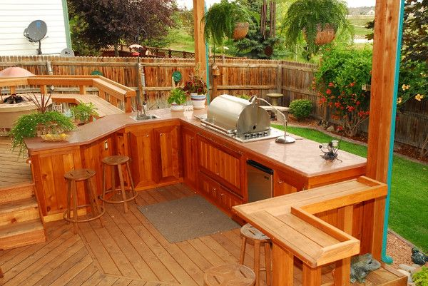 redwood outdoor patio with built in kitchen and bar