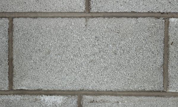 How To Attach Wood To Cinder Blocks Hunker Cinder Block Walls Concrete Block Walls Cinder Block