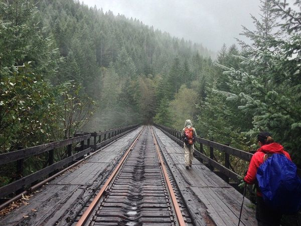 Abandoned train equipment and dark tunnels are among the highlights along the Salmonberry River trail. Here's why you should explore it now.