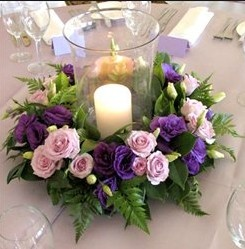 Was thinking this, maybe altenating with teh square vase roses idea.  Assume less flowers needed if a ring around a hurricane vase display?  Could any lavender be stuck in here?