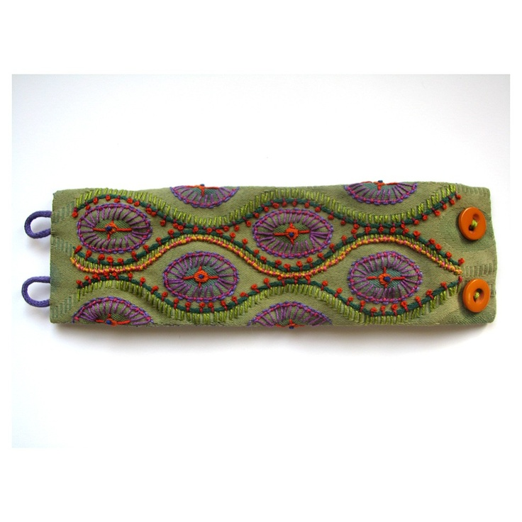 Hand Embroidered Cuff on Green Fabric Sample