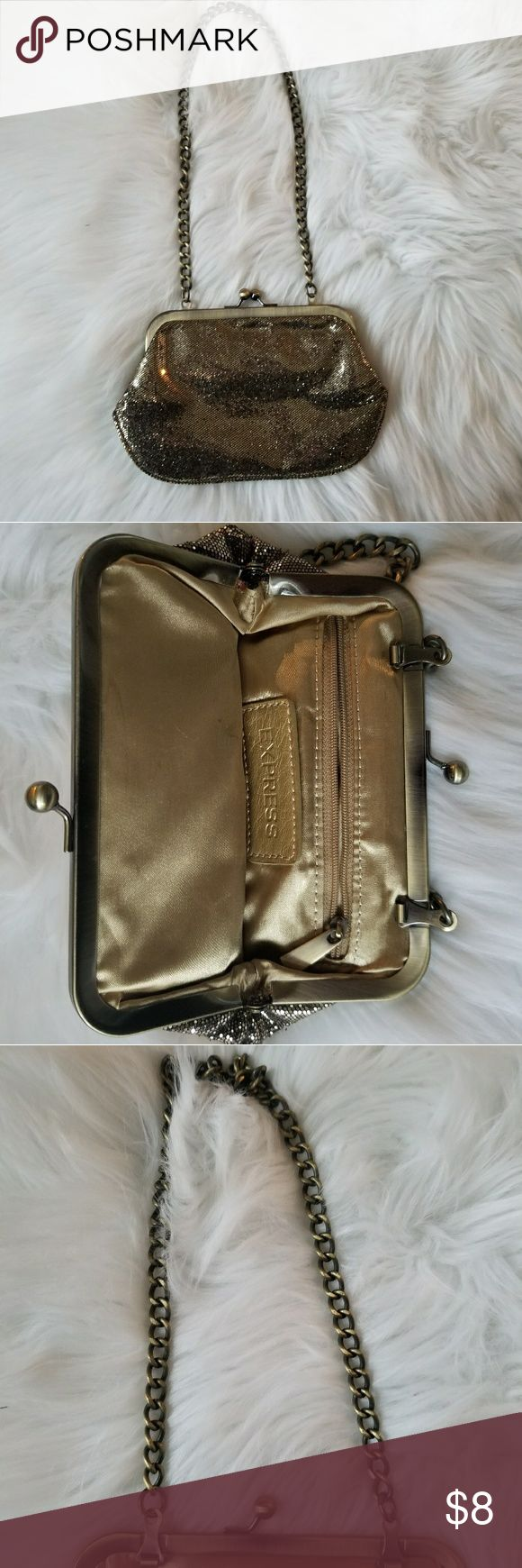 """Express Gold Sparkle Clutch Fun gold glitter clutch from express with bronze straps. Perfect for a night out or new years eve. Gold satin interior with a few marks as pictured in photos but otherwise in perfect condition. Clutch/purse is 5""""H x 8""""W with 11"""" straps. Express Bags Clutches & Wristlets"""